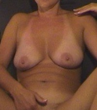 amateur photo The wife's tanlines while she plays on webcam.
