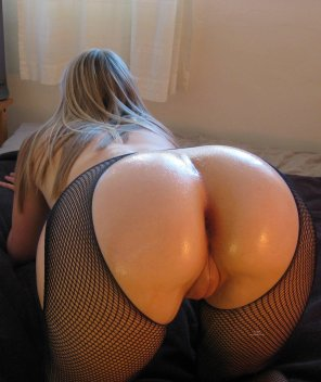 amateur photo Oiled up and in fishnets