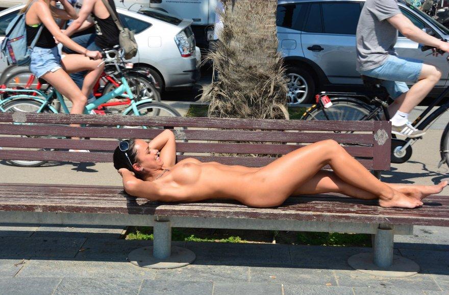 Nude sunbathing on a public bench Porn Photo