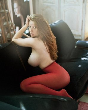 amateur photo Busty redhead on couch