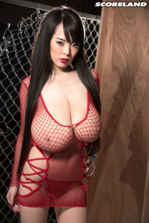amateur photo Hitomi Tanaka wearing a red fishnet dress