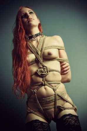 amateur photo Pull of her harness gripped into a knotted rose...