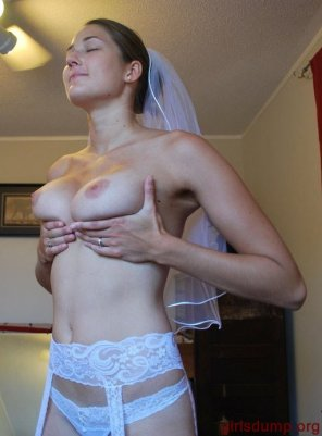 amateur photo She's prepared for more than a kiss from the groom