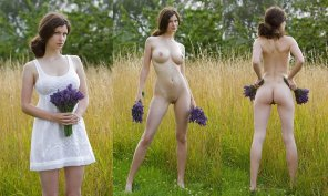 amateur photo Picking purple flowers in a field