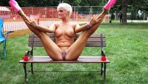 amateur photo spread eagle on a park bench