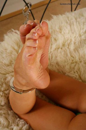 amateur photo Feet cuffed to the bed