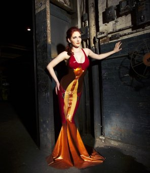 amateur photo Hot Redhead in a fancy latex dress