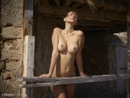 Exposing her breasts to the sun