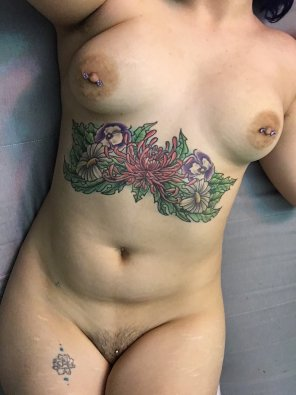amateur photo I've got lots o[f] hidden piercings and tattoos