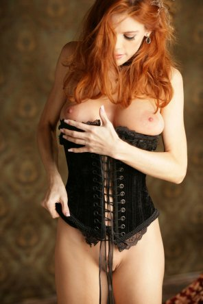 amateur photo Popping out of her corset