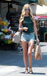 amateur photo Rosie Huntington Whiteley - wearing jean shorts and tight top showing her nipples