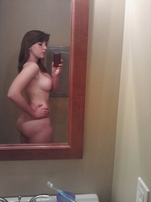 amateur photo Checking herself out
