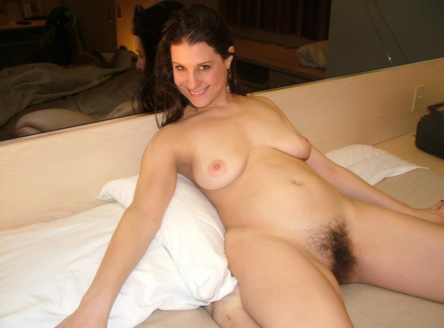 This amateur chick is proud of her bush Porn Photo