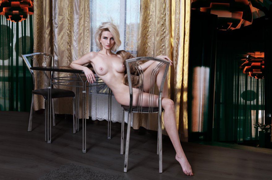 amateur photo Platinum Blonde lounging on a Chair