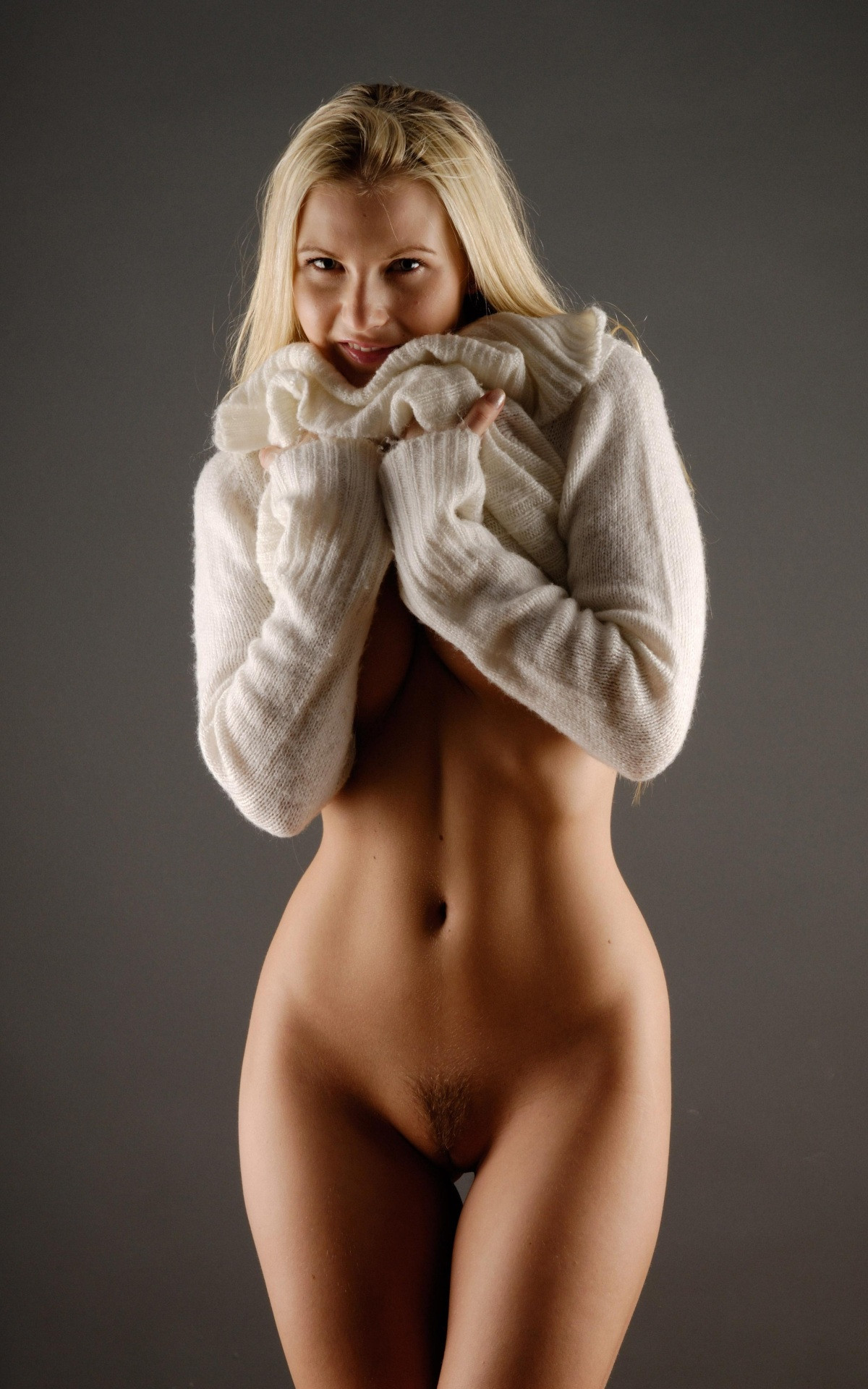 Nude blonde in sweater, beautiful girl teasing gallery
