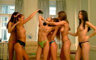 It must be really hot in that room, nice of her friends to cool her off like that
