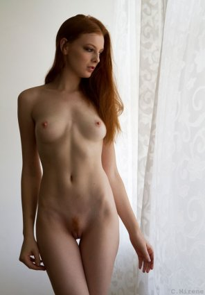 amateur photo Standing by the curtains