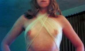 amateur photo MILF braless in see through scarf