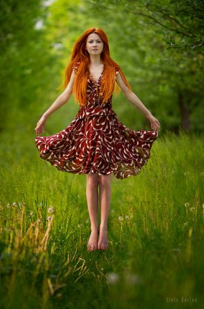 amateur photo Beautiful redhead in the nature