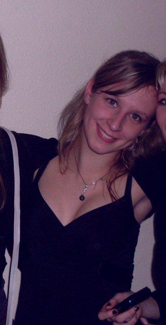 Cute blonde in black dress Porn Photo