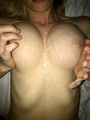 amateur photo No better way to end the year than cumming on my wife's tits. Happy New Years!