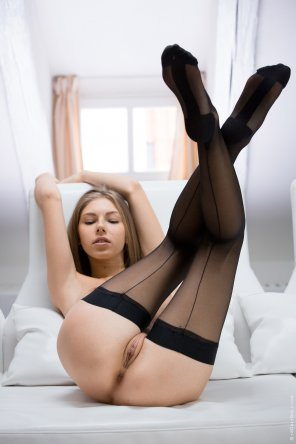 amateur photo Anjelica Ebbi displaying her fine stockings