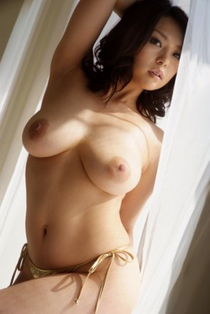 amateur photo Hot Asian girl by the window