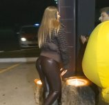 Round ass in tight leather pants