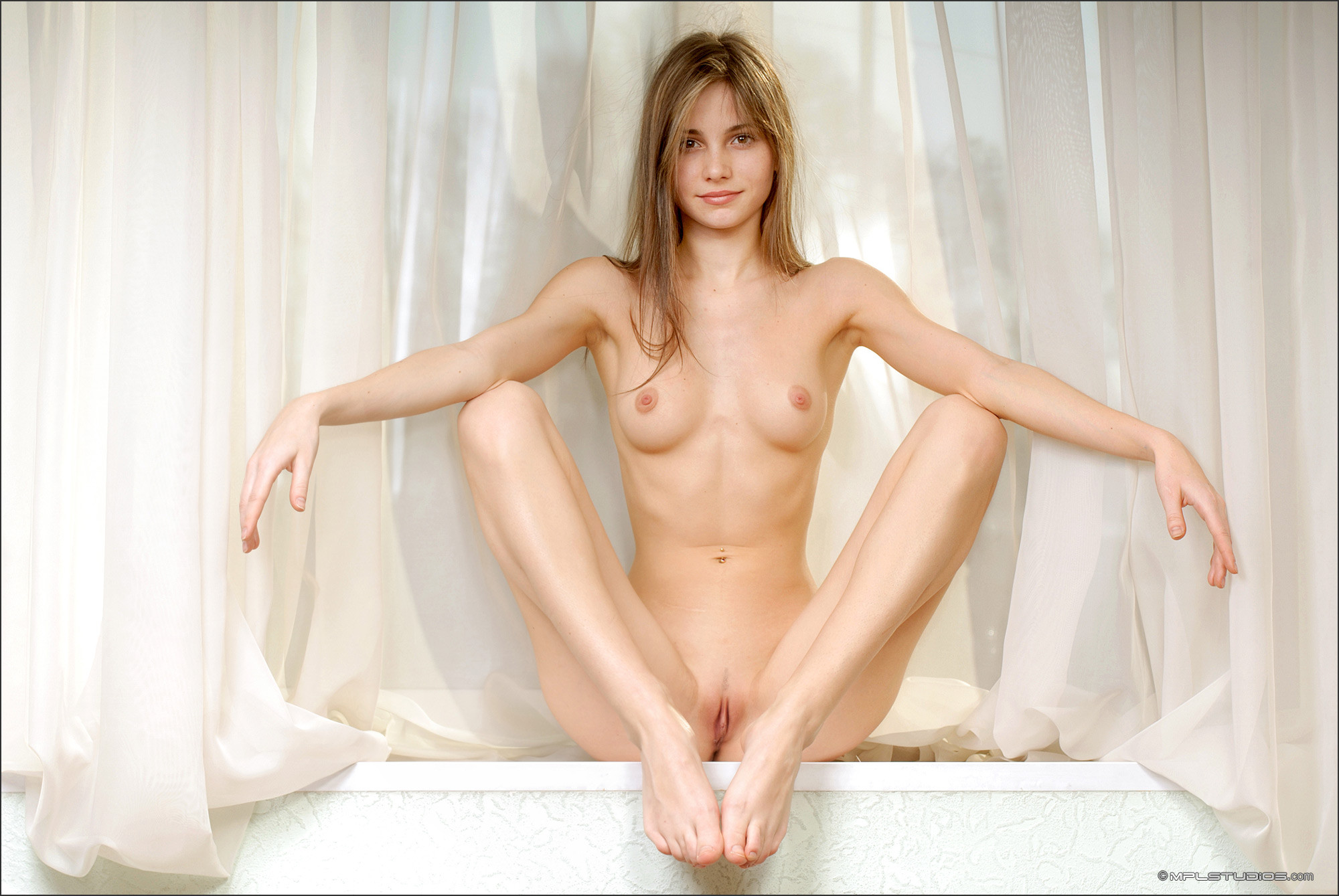 Nude women in military uniform