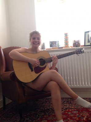 amateur photo Always happy playing the guitar
