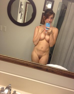 amateur photo Cute amateur with a little bush taking a selfie