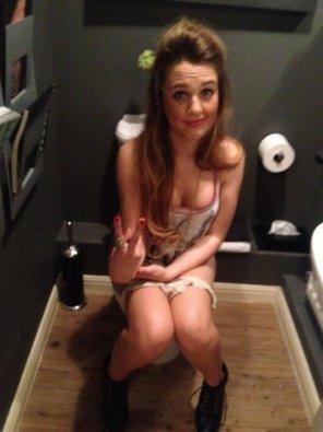 amateur photo On toilet