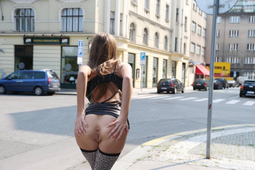 Spreading her asshole in public Porn Photo