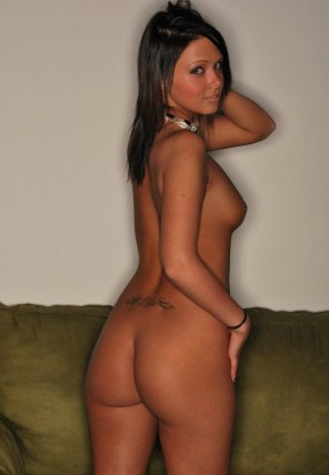 amateur photo Bailey Knox on a green couch