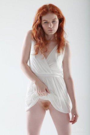 amateur photo Lifting her dress