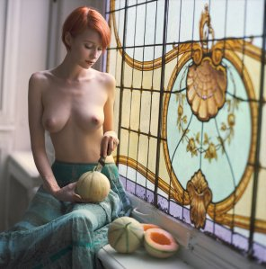 amateur photo Sitting at the window with her melons.