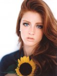 amateur photo Blue eyed redhead and sunflower