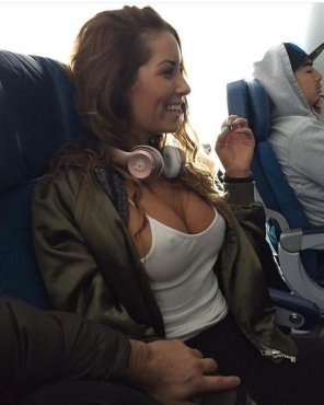amateur photo What will you do If she comes and sit Next to you on the Plane??