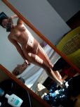 amateur photo Awesome body in a messy room