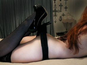 amateur photo Naughty redhead teases with her perfect ass