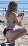 amateur photo squatting for a picture