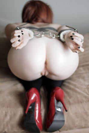 amateur photo Pale beauty with her ass up and handcuffed.