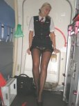 amateur photo Lufthansa Stewardess pulling up her dress