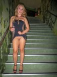amateur photo Beautiful blonde in a tight dress flashing her shaved pussy.