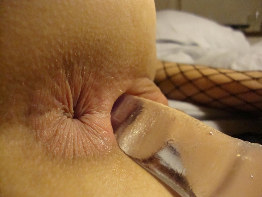 Close up asshole and a toy in her pussy Porn Photo