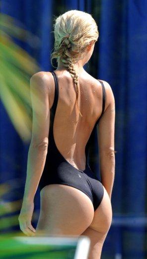 amateur photo One piece suit reveals her curvy bottom