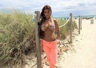 Busty beach brunette