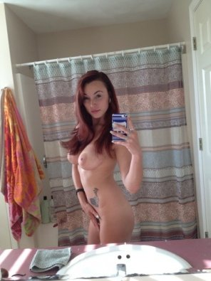 amateur photo in front of her shower curtain