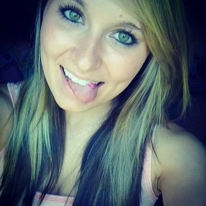 amateur photo Gorgeous blonde with a tongue ring