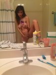 amateur photo Touching herself while taking a bathroom selfie